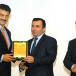 Ambassador of Azerbaijan, H.E Dashgin Shikarov presenting shield to Senator Dr Shahzad Waseem Advisor to the Chairman Pakistan Tehreek-e-Insaf — with Dr Abdul Basit at Preston University, H-8.