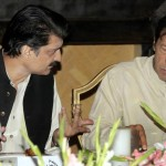 Adviser to Chairman PTI Dr Shahzad Waseem in discussion with Imran Khan (official)