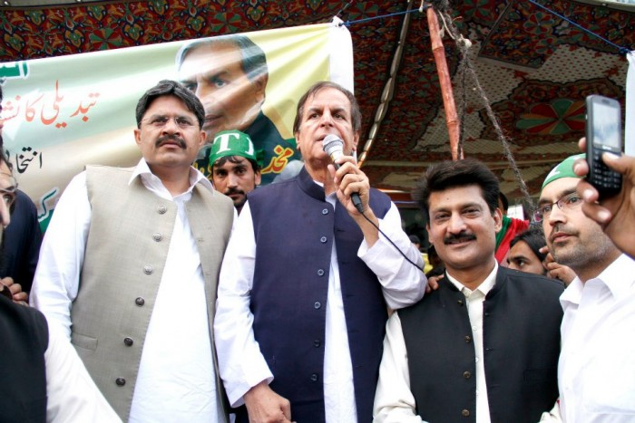 PTI President Javed Hashmi, flanked by Dr Shahzad Waseem