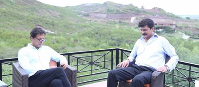 Central Secretary Foreign Affairs Dr Shahzad Waseem at Bani Gala with Chairman PTI Imran Khan (official).