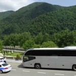 Our Bus being escorted by Azari Security during our visit Caucasian Mountains.