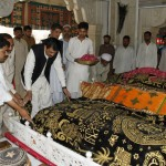 Dr Shahzad Waseem, Advisor to Chairman PTI, offers Fateha and lays veil of respect on grave of reverted saint Golra Sharif in Islamabad NA48