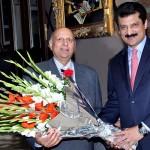 PTI leader and former senator Dr Shahzad Waseem presenting bouquet to Chaudhary Muhammad Sarwar