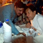 Sheikh Rasheed and Chief guest Chairman PTI Imran Khan discussing at Iftar Dinner hosted by Dr Shahzad Waseem.
