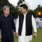 Dr Shahzad Waseem and Shah Mehmood Qureshi discussing at Iftar Dinner hosted by Dr Shahzad Waseem.