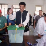 Pakistan Tahreek-e-Insaf Leader Dr Shahzad Waseem casting his vote at a polling station in Islamabad