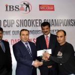 Chief guest H.E. Mr. Dashgin Shikarov presenting shield and cash prize to Mr. Gul Afzal, winner of 4th Islamabad Snooker Championship.