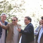 Dr Shahzad Waseem in discussion with other party leaders at Bani Gala Islamabad