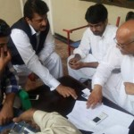 Dr Shahzad Waseem visiting camps at NA122 polling stations for polling day preparation.