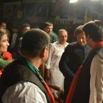 Dr Shahzad Waseem welcoming chairmam PTI Imran Khan at stage.