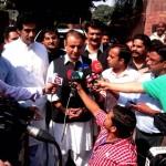 Dr Shahzad Waseem with Abdul Aleem Khan talking to media.