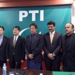 Exchange of souvenirs between H.E Zheng Xiaosong China V Minister & Chairman PTI Imran Khan at Bani gala.