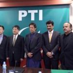 Exchange of souvenirs between H.E Zheng Xiaosong China V Minister & Chairman PTI Imran Khan at Bani gala.