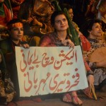 PTI Supporter hold banner again irregularities in Election 2013