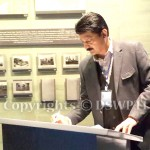 Dr Shahzad Waseem writing remarks at Guba genocide memorial complex